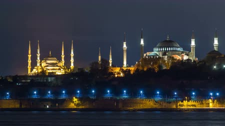 constantine : Hagia Sophia and Blue Mosque timelapse at night reflected in Bosphorus water. Istanbul, Turkey
