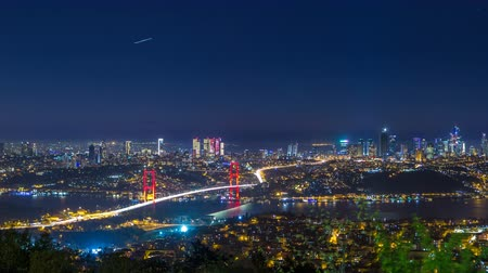 asma : Istanbul city skyline cityscape night time lapse view of bosphorus bridge and financial business center Stok Video