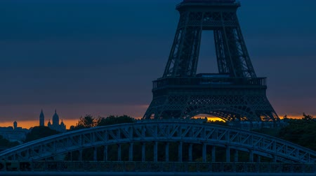 eifel : Eiffel Tower sunrise timelapse with boats on Seine river and in Paris, France.