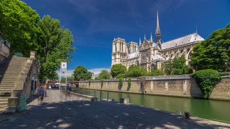 Seine and Notre Dame de Paris timelapse hyperlapse is the one of the most famous symbols of Paris Stock Footage