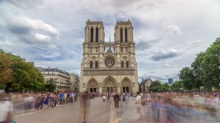 Front view of Notre-Dame de Paris timelapse hyperlapse, a medieval Catholic cathedral on the Cite Island in Paris, France