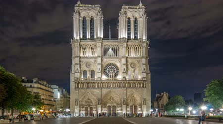 creed : Night View of Notre Dame de Paris timelapse, France and square in front of the cathedral with people Stock Footage