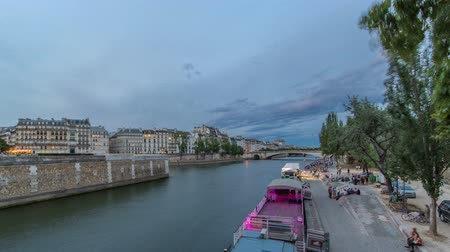 pont : View to the Pont De La Tournelle on the River Seine day to night timelapse with embankment.