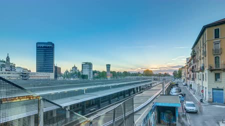 пригородный : Garibaldi train station at sunset timelapse in Milan, Italy Стоковые видеозаписи