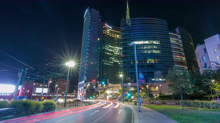 garibaldi : Milan skyline with modern skyscrapers in Porta Nuova business district night timelapse hyperlapse in Milan, Italy Stock Footage