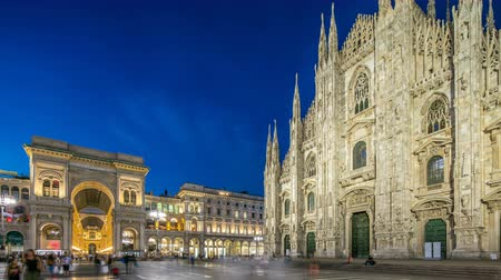 externo : Cathedral Duomo di Milano and Vittorio Emanuele gallery day to night timelapse in Square Piazza Duomo, Milan, Italy.