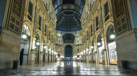 milan fashion : Entrance to the Galleria Vittorio Emanuele II timelapse from Via Tommaso Grossi at night.