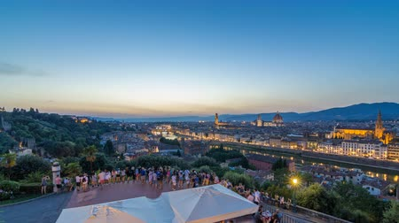 arno : Scenic Skyline View of Arno River day to night timelapse, Ponte Vecchio from Piazzale Michelangelo at Sunset, Florence, Italy.