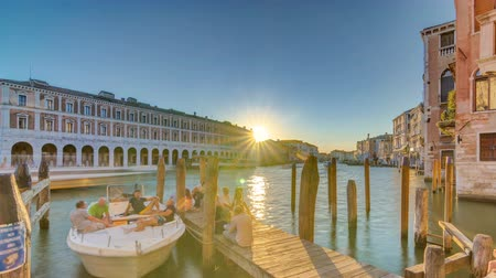 ponte : View of the deserted Rialto Market at sunset timelapse, Venice, Italy viewed from pier across the Grand Canal