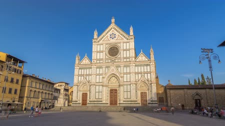 piazza del duomo : Tourists on Piazza di Santa Croce timelapse hyperlapse with Basilica di Santa Croce Basilica of the Holy Cross in Florence city.