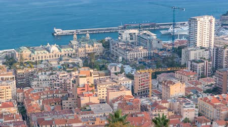 cote : Cityscape timelapse of Monte Carlo, Monaco with roofs of buildings during summer sunset. Stock Footage