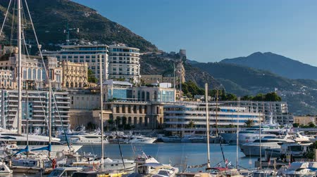 lapso de tempo : Monte Carlo Port Hercule panorama timelapse. View of luxury yachts and casino of Monaco, Cote dAzur.
