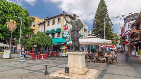 markiza : The Cumhuriyet square with numerous cafes and bars, statue of Attalos II and souvenir stores timelapse hyperlapse in Antalya.