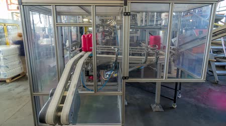 packager : A factory for plastic canister production timelapse hyperlapse. The conveyor in the factory. Stock Footage