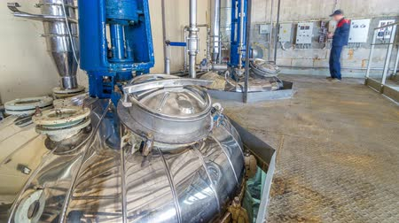 electromotor : A number of steel tanks for mixing liquids timelapse hyperlapse. Stainless steel, industry.