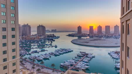 porto arabia : Sunset at the Pearl-Qatar timelapse from top.