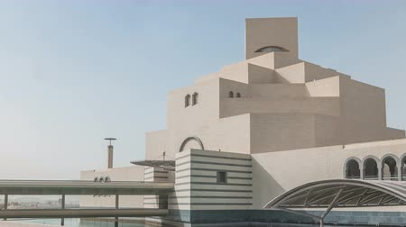 woodcut : Qatars museum of Islamic Art timelapse on its man-made island beside Doha Corniche