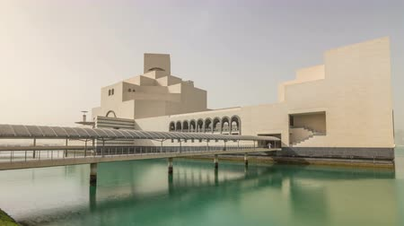 woodcut : Qatars museum of Islamic Art timelapse hyperlapse on its man-made island beside Doha Corniche