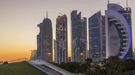 water feature : The high-rise district of Doha day to night timelapse after sunset Stock Footage