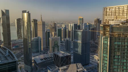 corniche : Skyline of West Bay and Doha City Center during sunrise timelapse, Qatar