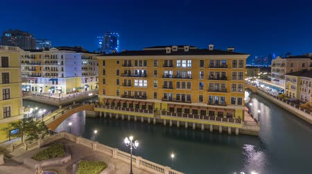 east pearl : Canal aerial top view in Venice-like Qanat Quartier of the Pearl precinct of Doha night timelapse, Qatar. Stock Footage