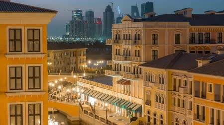 east pearl : Canal aerial top view in Venice-like Qanat Quartier of the Pearl precinct of Doha day to night timelapse, Qatar. Stock Footage