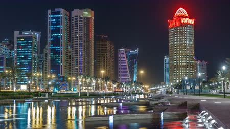sheraton : The skyline of Doha by night with starry sky seen from Park timelapse, Qatar