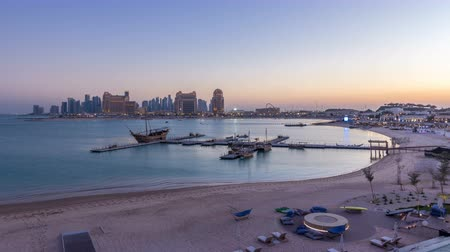 east pearl : View from Katara Beach day to night timelapse in Doha, Qatar, towards the West Bay and city center