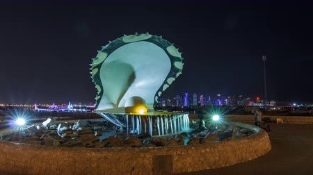 gigantikus : A fountain featuring an oyster with a gigantic pearl inside night timelapse hyperlapse with the Doha skyline behind it
