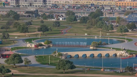 aspire : Bridge with fountain and lake in the Aspire park timelapse in Doha, Qatar