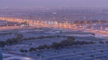 aspire : Aerial view of Aspire Zone from top night to day timelapse in Doha