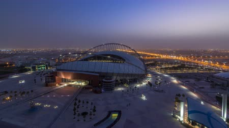 aspire : Aerial view of Aspire Zone stadium from top night to day timelapse in Doha