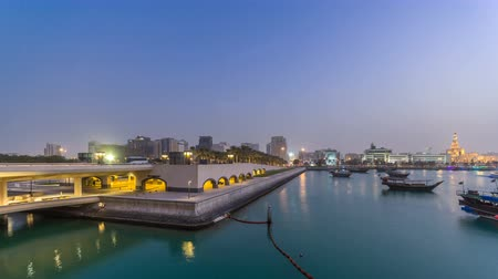 islámský : View of the Doha city in front of the Museum of Islamic Art day to night timelapse in the Qatari capital, Doha.