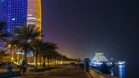 sheraton : The skyline of Doha by night with starry sky seen from Corniche timelapse, Qatar Stock Footage