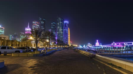 sheraton : The skyline of Doha by night with starry sky seen from Corniche timelapse hyperlapse, Qatar Stock Footage