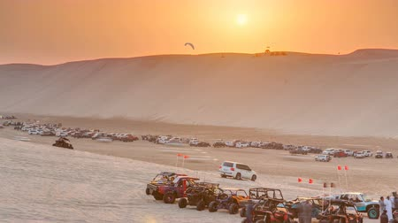 reddish : Buggies in sand desert at the sunset timelapse Stock Footage