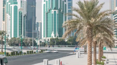 bank tower : The high-rise district of Doha with traffic on intersection timelapse Stock Footage