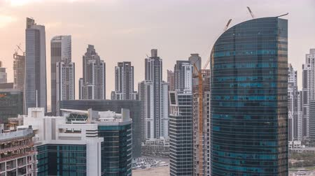 prestiž : Dubai business bay towers at sunset aerial timelapse.