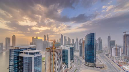 эмираты : Dubai business bay towers at sunset aerial timelapse.