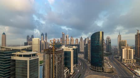 prestiž : Dubai business bay towers early morning aerial timelapse.