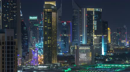 khalifa : Aerial cityscape timelapse at night with illuminated modern architecture in Downtown of Dubai, United Arab Emirates.