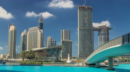 lavish : Burj park with fountain pool and bridge timelapse.
