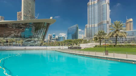 lavish : Burj park with fountain pool timelapse hyperlapse.