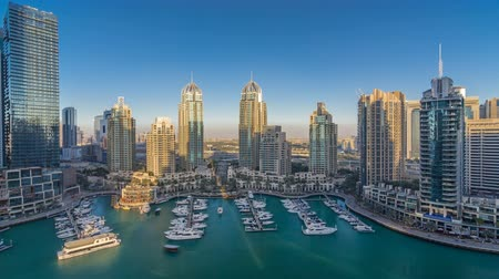 lavish : Dubai Marina skyscrapers aeral timelapse, port with luxury yachts and marina promenade