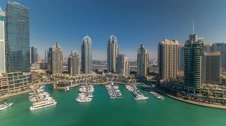 lavish : Dubai Marina skyscrapers aeral all day timelapse, port with luxury yachts and marina promenade Stock Footage