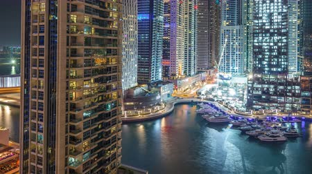 лодки : Dubai Marina at night timelapse, Glittering lights and tallest skyscrapers