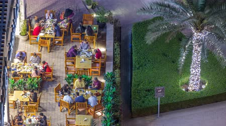 gyalogút : Modern embankment timelapse with bar, Cafe and Restaurant in famous Dubai Marina.
