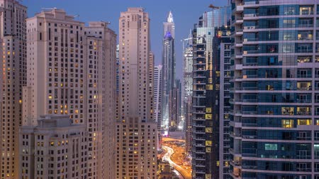 adresa : Evening illumination of Dubai Marina day to night aerial timelapse, UAE.