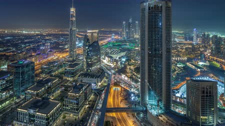 birleşik arap emirlikleri : Dubai Downtown day to night timelapse modern towers panoramic view from the top in Dubai, United Arab Emirates. Stok Video