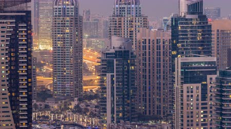 ОАЭ : Beautiful aerial top view day to night transition timelapse of Dubai Marina